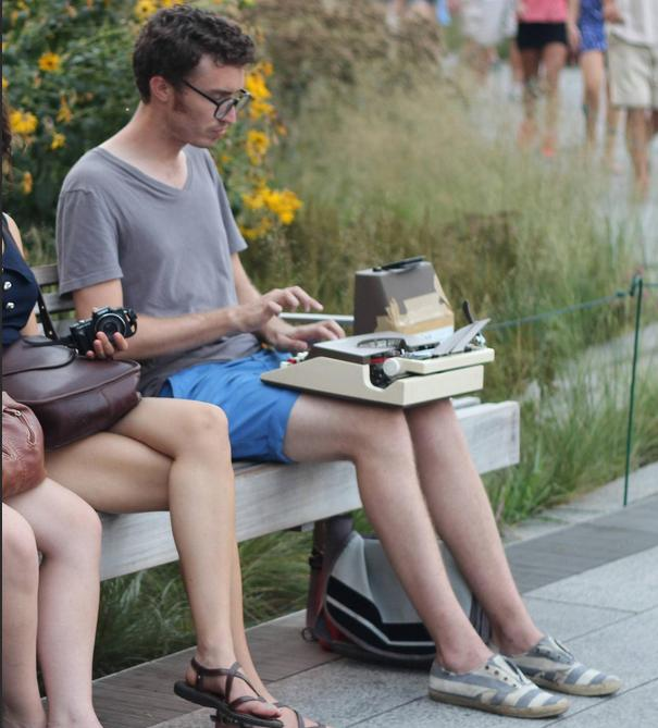 the photo of the typewriter busker who got hated on for being a hipster