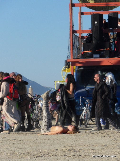 girl doing yoga at Burning Man