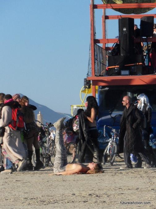 girl doing yoga at Burning Man