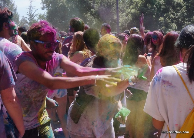 A stranger and I toss color onto another stranger at Holi